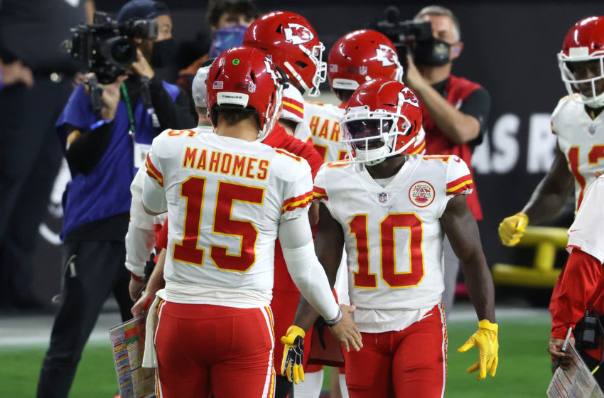 LAS VEGAS, NEVADA - NOVEMBER 22: Quarterback Patrick Mahomes #15 congratulates wide receiver Tyreek Hill #10 of the Kansas City Chiefs after his touchdown reception during the first half of an NFL game against the Las Vegas Raiders at Allegiant Stadium on November 22, 2020 in Las Vegas, Nevada. (Photo by Christian Petersen/Getty Images)