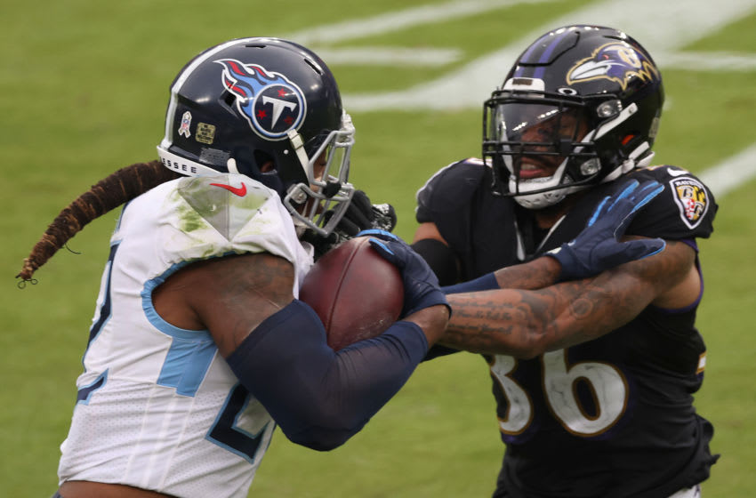 BALTIMORE, MARYLAND - NOVEMBER 22: Running back Derrick Henry #22 of the Tennessee Titans stiff arms strong safety Chuck Clark #36 of the Baltimore Ravens in the second half at M&T Bank Stadium on November 22, 2020 in Baltimore, Maryland. (Photo by Rob Carr/Getty Images)