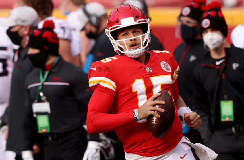 KANSAS CITY, MISSOURI - DECEMBER 27: Patrick Mahomes #15 of the Kansas City Chiefs runs out of bounds against the Atlanta Falcons during the second quarter at Arrowhead Stadium on December 27, 2020 in Kansas City, Missouri. (Photo by Jamie Squire/Getty Images)