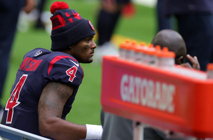 HOUSTON, TEXAS - DECEMBER 27: Quarterback Deshaun Watson #4 of the Houston Texans looks on from the bench late in the fourth quarter of the game against the Cincinnati Bengals at NRG Stadium on December 27, 2020 in Houston, Texas. (Photo by Carmen Mandato/Getty Images)