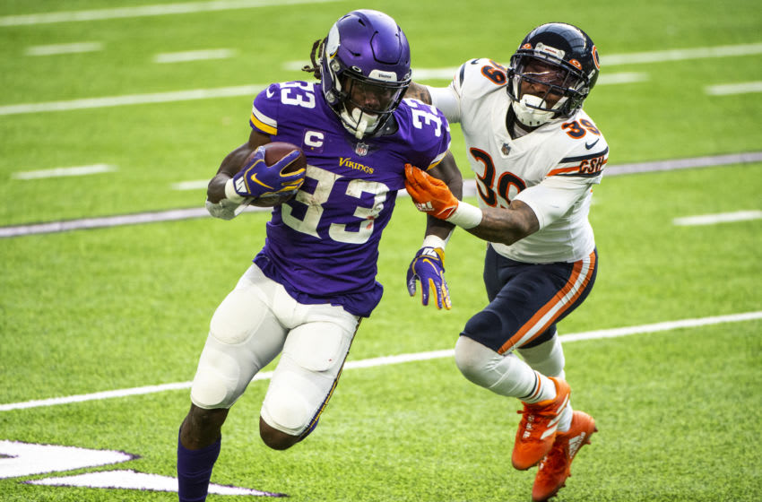 MINNEAPOLIS, MN - DECEMBER 20: Dalvin Cook #33 of the Minnesota Vikings runs with the ball in the second quarter of the game against the Chicago Bears at U.S. Bank Stadium on December 20, 2020 in Minneapolis, Minnesota. (Photo by Stephen Maturen/Getty Images)