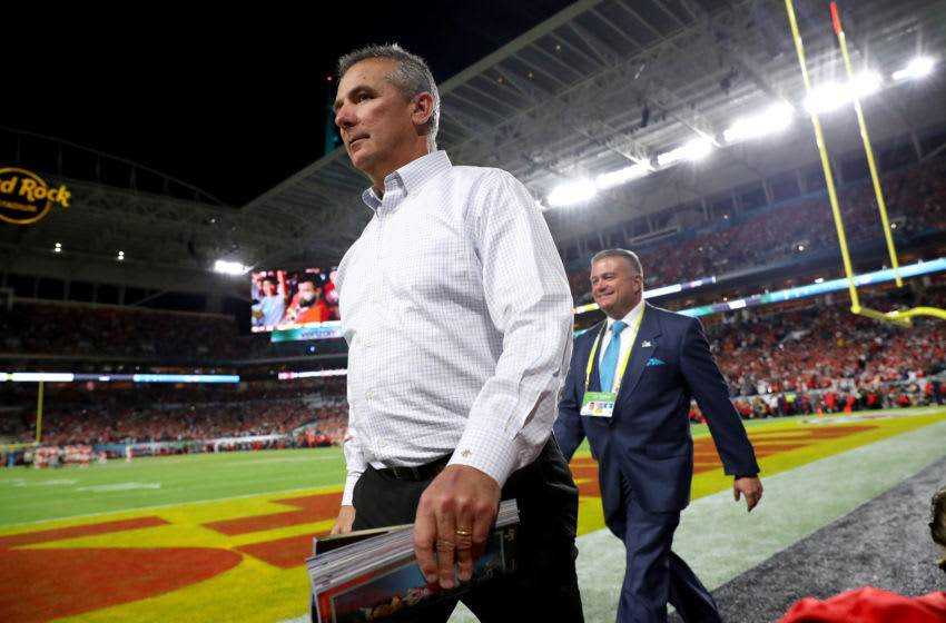 MIAMI, FLORIDA - FEBRUARY 02: Urban Meyer walks on the field in Super Bowl LIV at Hard Rock Stadium on February 02, 2020 in Miami, Florida. (Photo by Maddie Meyer/Getty Images)