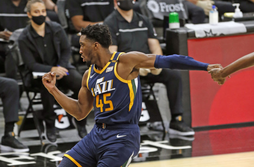 SAN ANTONIO, TX - JANUARY 3: Donovan Mitchell #45 of the Utah Jazz celebrates after a basket against the San Antonio Spurs at AT&T Center on January 3, 2021 in San Antonio, Texas. NOTE TO USER: User expressly acknowledges and agrees that , by downloading and or using this photograph, User is consenting to the terms and conditions of the Getty Images License Agreement. (Photo by Ronald Cortes/Getty Images)