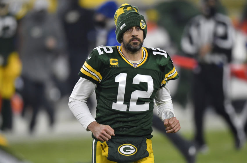 GREEN BAY, WISCONSIN - DECEMBER 19: Quarterback Aaron Rodgers #12 of the Green Bay Packers leaves the field at halftime of the game against the Carolina Panthers at Lambeau Field on December 19, 2020 in Green Bay, Wisconsin. (Photo by Quinn Harris/Getty Images)