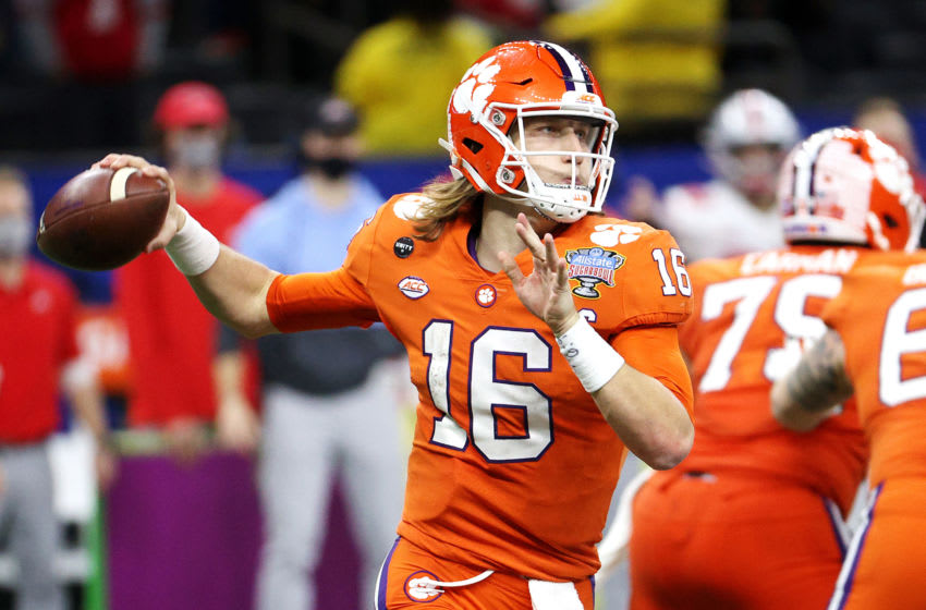 NEW ORLEANS, LOUISIANA - JANUARY 01: Trevor Lawrence #16 of the Clemson Tigers passes against the Ohio State Buckeyes in the second half during the College Football Playoff semifinal game at the Allstate Sugar Bowl at Mercedes-Benz Superdome on January 01, 2021 in New Orleans, Louisiana. (Photo by Chris Graythen/Getty Images)
