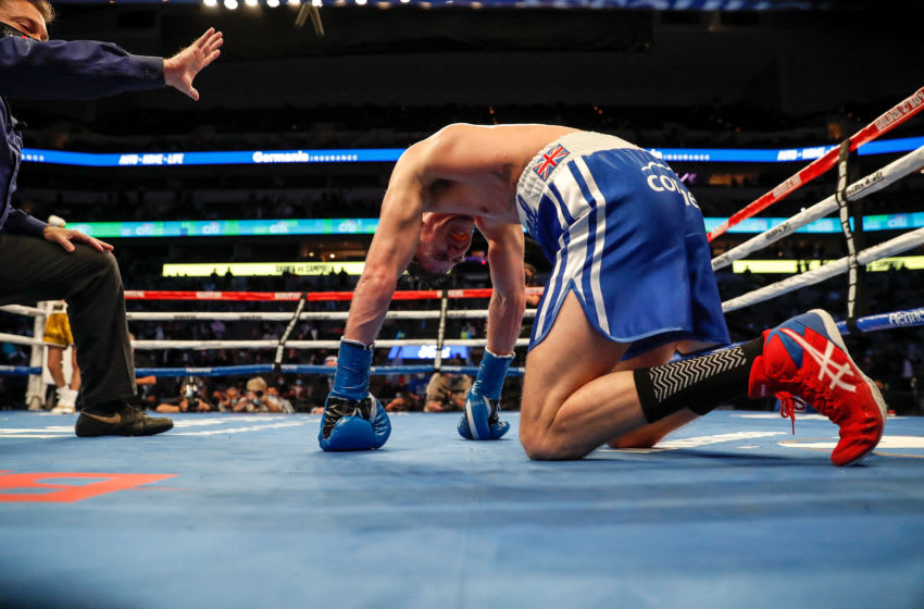 DALLAS, TEXAS - JANUARY 02: Luke Campbell kneels on the canvas after a body shot by Ryan Garcia during the WBC Interim Lightweight Title fight at American Airlines Center on January 02, 2021 in Dallas, Texas. (Photo by Tim Warner/Getty Images)