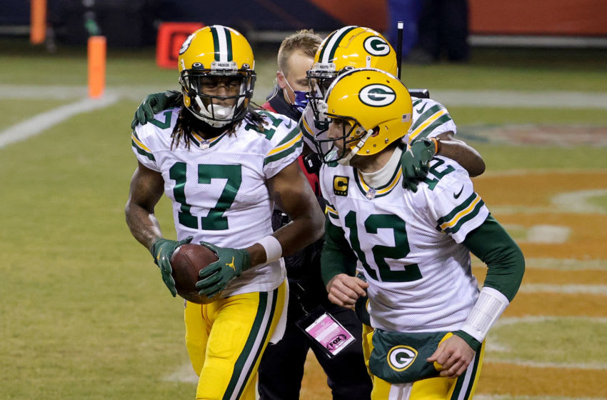 CHICAGO, ILLINOIS - JANUARY 03: Davante Adams #17 of the Green Bay Packers celebrates with Aaron Rodgers #12 after scoring a touchdown against the Chicago Bears during the fourth quarter in the game at Soldier Field on January 03, 2021 in Chicago, Illinois. (Photo by Jonathan Daniel/Getty Images)