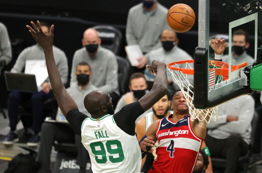 BOSTON, MASSACHUSETTS - JANUARY 08: Tacko Fall #99 of the Boston Celtics defends Russell Westbrook #4 of the Washington Wizards during the first quarter at TD Garden on January 08, 2021 in Boston, Massachusetts. NOTE TO USER: User expressly acknowledges and agrees that, by downloading and or using this photograph, User is consenting to the terms and conditions of the Getty Images License Agreement. (Photo by Maddie Meyer/Getty Images)