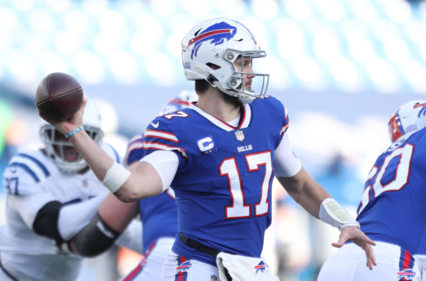 ORCHARD PARK, NEW YORK - JANUARY 09: Josh Allen #17 of the Buffalo Bills passes the football during the second half of the AFC Wild Card playoff game against the Indianapolis Colts at Bills Stadium on January 09, 2021 in Orchard Park, New York. (Photo by Bryan M. Bennett/Getty Images)