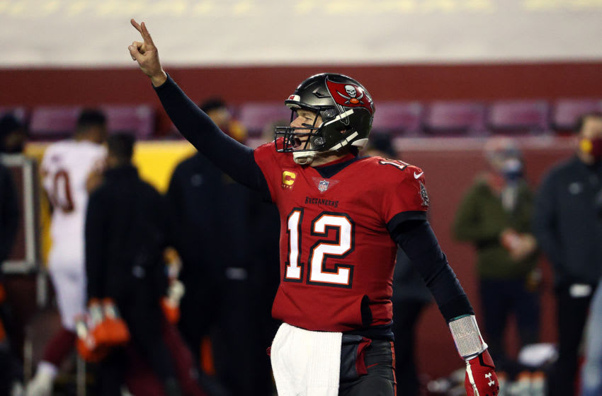 LANDOVER, MARYLAND - JANUARY 09: Quarterback Tom Brady #12 of the Tampa Bay Buccaneers calls for a two-point conversion after a touchdown during the 2nd quarter of the game against the Washington Football Team at FedExField on January 09, 2021 in Landover, Maryland. (Photo by Patrick Smith/Getty Images)