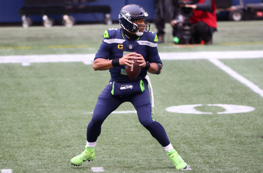SEATTLE, WASHINGTON - JANUARY 09: Russell Wilson #3 of the Seattle Seahawks looks to throw the ball in the first quarter against the Los Angeles Rams during the NFC Wild Card Playoff game at Lumen Field on January 09, 2021 in Seattle, Washington. (Photo by Abbie Parr/Getty Images)