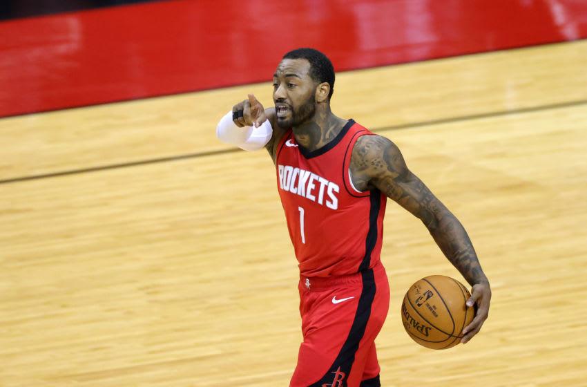 HOUSTON, TEXAS - JANUARY 10: John Wall #1 of the Houston Rockets (Photo by Carmen Mandato/Getty Images)