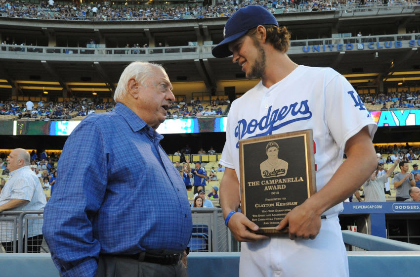 LOS ANGELES, CA - SEPTEMBER 28: Pitcher Clayton Kershaw #22 (R) of the Los Angeles Dodgers accepts The Campanella Award from Tommy Lasorda before the game against the Colorado Rockies at Dodger Stadium on September 28, 2013 in Los Angeles, California. (Photo by Lisa Blumenfeld/Getty Images)
