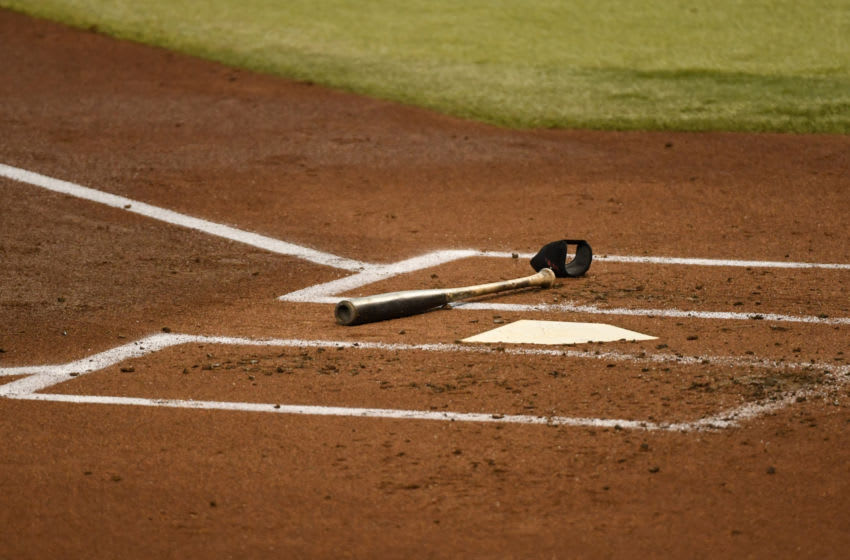 PHOENIX, ARIZONA - SEPTEMBER 13: A detail of a bat and elbow guard laying next to home plate during a game between the Arizona Diamondbacks and the Seattle Mariners at Chase Field on September 13, 2020 in Phoenix, Arizona. (Photo by Norm Hall/Getty Images)