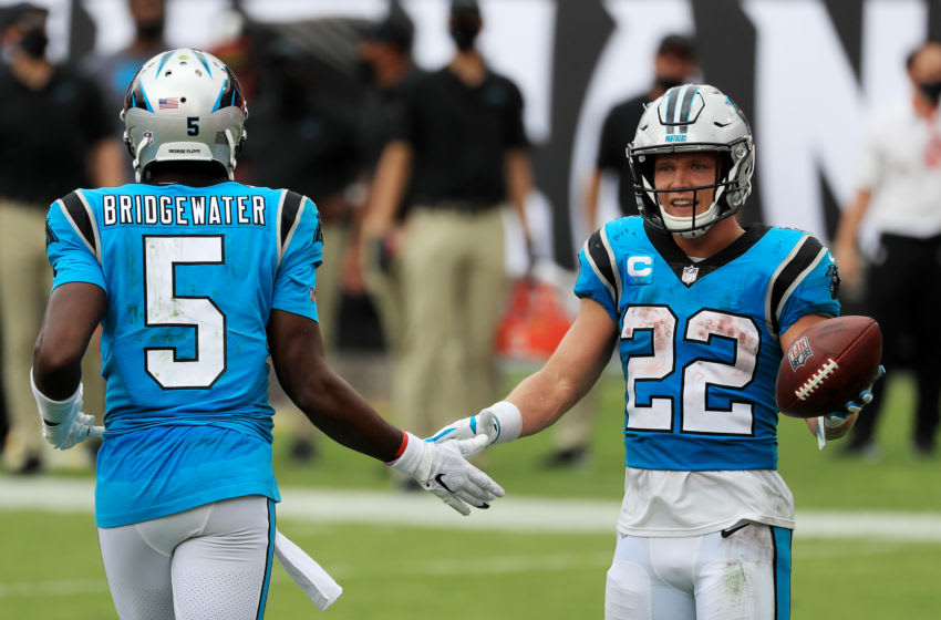 TAMPA, FLORIDA - SEPTEMBER 20: Christian McCaffrey #22 of the Carolina Panthers celebrates with Teddy Bridgewater #5 after scoring a touchdown during the third quarter against the Tampa Bay Buccaneers at Raymond James Stadium on September 20, 2020 in Tampa, Florida. (Photo by Mike Ehrmann/Getty Images)