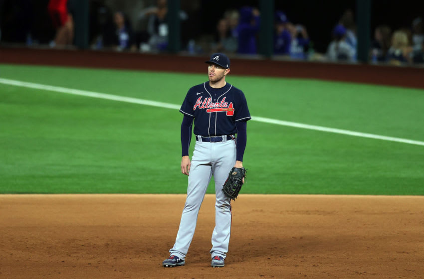 ARLINGTON, TEXAS - OCTOBER 18: Freddie Freeman #5 of the Atlanta Braves looks on against the Los Angeles Dodgers during the eighth inning in Game Seven of the National League Championship Series at Globe Life Field on October 18, 2020 in Arlington, Texas. (Photo by Ronald Martinez/Getty Images)