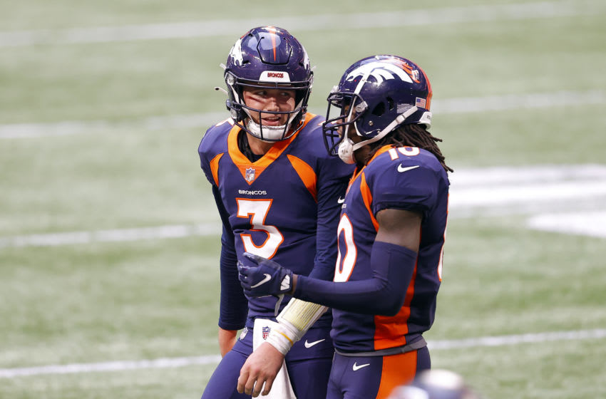 ATLANTA, GEORGIA - NOVEMBER 08: Drew Lock #3 of the Denver Broncos talks with Jerry Jeudy #10 during the fourth quarter against the Atlanta Falcons at Mercedes-Benz Stadium on November 08, 2020 in Atlanta, Georgia. (Photo by Kevin C. Cox/Getty Images)