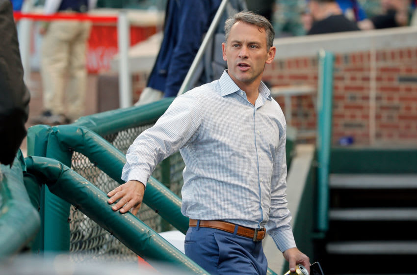 CHICAGO, IL - APRIL 18: Executive Vice President and General Manager Jed Hoyer of the Chicago Cubs talks to media as he walks in to the dugout before the game against the Milwaukee Brewers at Wrigley Field on April 18, 2017 in Chicago, Illinois. (Photo by Jon Durr/Getty Images)