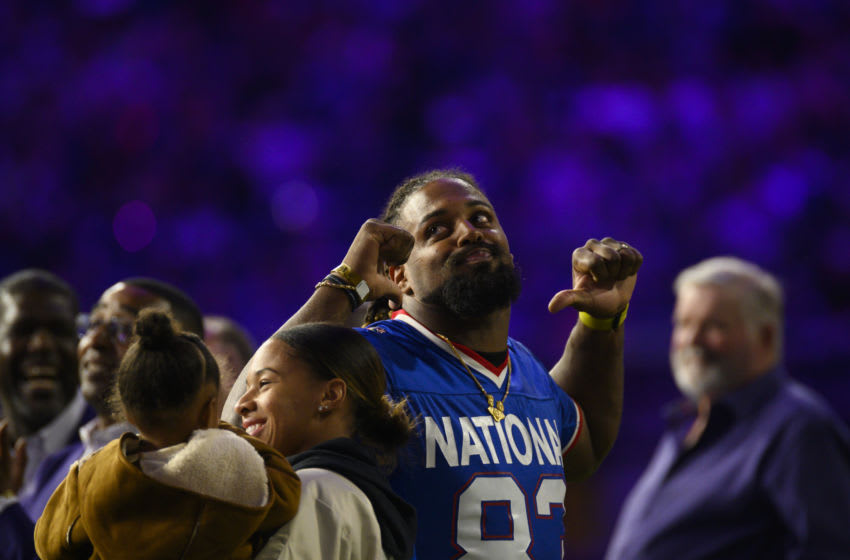MINNEAPOLIS, MN - OCTOBER 24: Cam Jordan of the New Orleans Saints looks on as his father, Steve Jordan, is inducted into the Vikings Ring of Honor during halftime of the game between the Washington Redskins and Minnesota Vikings at U.S. Bank Stadium on October 24, 2019 in Minneapolis, Minnesota. Jordan wore his fathers pro bowl jersey to the event. (Photo by Stephen Maturen/Getty Images)