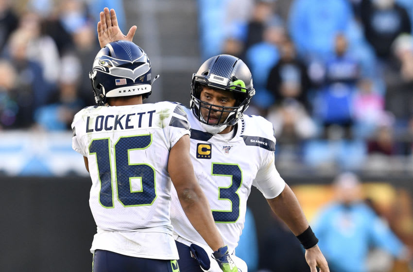 CHARLOTTE, NORTH CAROLINA - DECEMBER 15: Russell Wilson #3 encourages Tyler Lockett #16 of the Seattle Seahawks during the fourth quarter of their game against the Carolina Panthers at Bank of America Stadium on December 15, 2019 in Charlotte, North Carolina. (Photo by Grant Halverson/Getty Images)