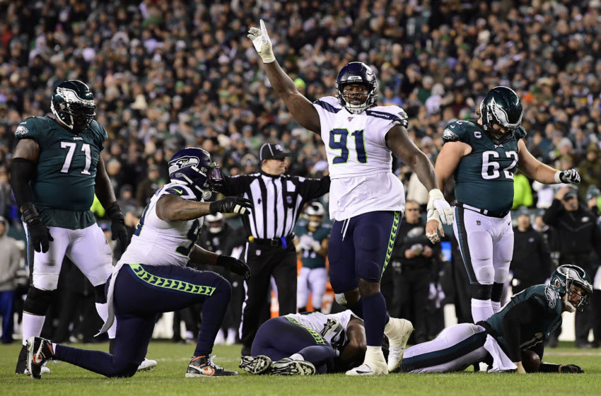 PHILADELPHIA, PENNSYLVANIA - JANUARY 05: Jarran Reed #91 of the Seattle Seahawks celebrates a defensive stop on quarterback Josh McCown #18 of the Philadelphia Eagles on fourth down in the fourth quarter of the NFC Wild Card Playoff game at Lincoln Financial Field on January 05, 2020 in Philadelphia, Pennsylvania. (Photo by Steven Ryan/Getty Images)