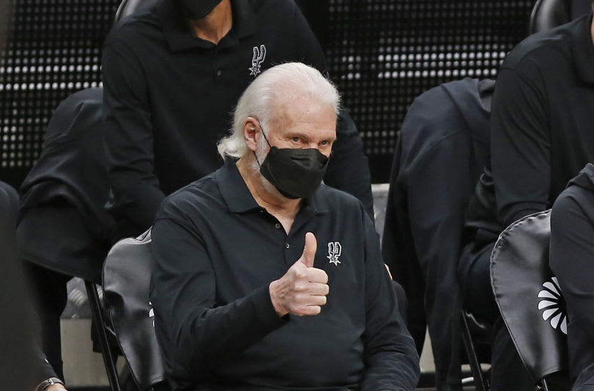 SAN ANTONIO, TX - FEBRUARY 08: Head coach Gregg Popovich of the San Antonio Spurs acknowledges Stephen Curry #30 (not pictured) of the Golden State Warriors before the start of the game at AT&T Center on February 8, 2021 in San Antonio, Texas. NOTE TO USER: User expressly acknowledges and agrees that , by downloading and or using this photograph, User is consenting to the terms and conditions of the Getty Images License Agreement. (Photo by Ronald Cortes/Getty Images)