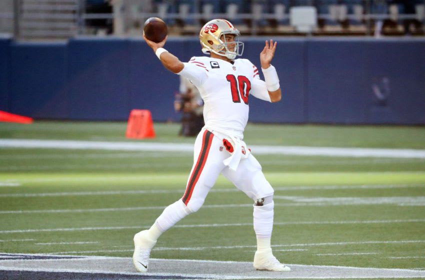 SEATTLE, WASHINGTON - NOVEMBER 01: Jimmy Garoppolo #10 of the San Francisco 49ers looks to throw the ball in the first quarter against the Seattle Seahawks at CenturyLink Field on November 01, 2020 in Seattle, Washington. (Photo by Abbie Parr/Getty Images)