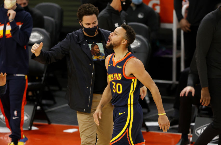 SAN FRANCISCO, CALIFORNIA - JANUARY 25: Stephen Curry #30 of the Golden State Warriors celebrates with Klay Thompson #11 after he made a three-point basket in the fourth quarter against the Minnesota Timberwolves at Chase Center on January 25, 2021 in San Francisco, California. NOTE TO USER: User expressly acknowledges and agrees that, by downloading and or using this photograph, User is consenting to the terms and conditions of the Getty Images License Agreement. (Photo by Ezra Shaw/Getty Images)