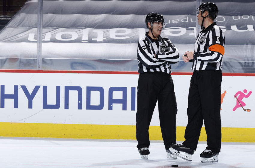 NHL officials (Photo by Tim Nwachukwu/Getty Images)