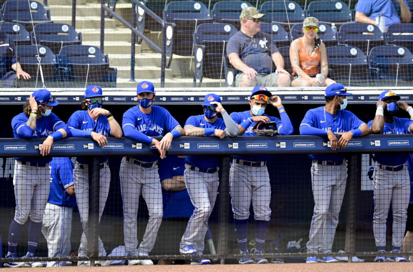 TAMPA, FLORIDA - FEBRUARY 28: Toronto Blue Jays players stand in the dugout prior to the game against the New York Yankees during a spring training game at George M. Steinbrenner Field on February 28, 2021 in Tampa, Florida. (Photo by Douglas P. DeFelice/Getty Images)