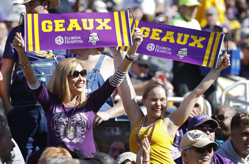 LSU Tigers fans celebrate after a touchdown against the Louisville Cardinals during the Buffalo Wild Wings Citrus Bowl at Camping World Stadium on December 31, 2016 in Orlando, Florida. LSU defeated Louisville 29-9. (Photo by Joe Robbins/Getty Images)