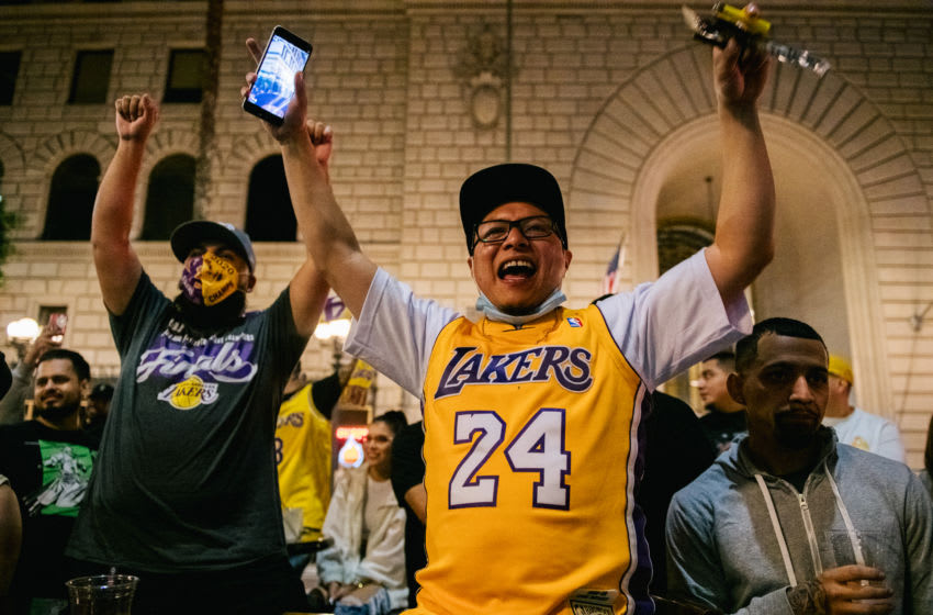 LOS ANGELES, CA - OCTOBER 11: Lakers fans celebrate at an outside bar on October 11, 2020 in Los Angeles, California. People gathered to celebrate after the Los Angeles Lakers defeated the Miami Heat in game 6 of the NBA finals. (Photo by Brandon Bell/Getty Images)