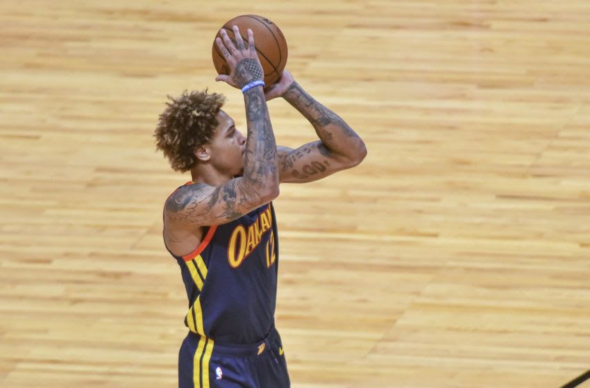 MIAMI, FL - APRIL 01: Kelly Oubre Jr. #12 of the Golden State Warriors shoots in the first half against the Miami Heat at American Airlines Arena on April 1, 2021 in Miami, Florida. NOTE TO USER: User expressly acknowledges and agrees that, by downloading and or using this photograph, User is consenting to the terms and conditions of the Getty Images License Agreement.(Photo by Eric Espada/Getty Images)