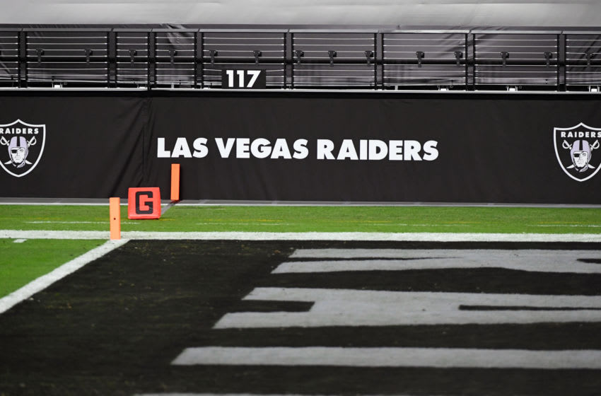 LAS VEGAS, NEVADA - DECEMBER 17: Las Vegas Raiders logos are shown on a wall before a game between the Raiders and the Los Angeles Chargers at Allegiant Stadium on December 17, 2020 in Las Vegas, Nevada. The Chargers defeated the Raiders 30-27 in overtime. (Photo by Ethan Miller/Getty Images)