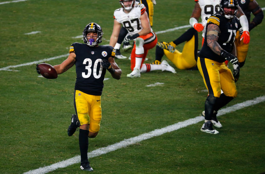 PITTSBURGH, PENNSYLVANIA - JANUARY 10: James Conner #30 of the Pittsburgh Steelers rushes for a touchdown during the first half of the AFC Wild Card Playoff game against the Cleveland Browns at Heinz Field on January 10, 2021 in Pittsburgh, Pennsylvania. (Photo by Justin K. Aller/Getty Images)