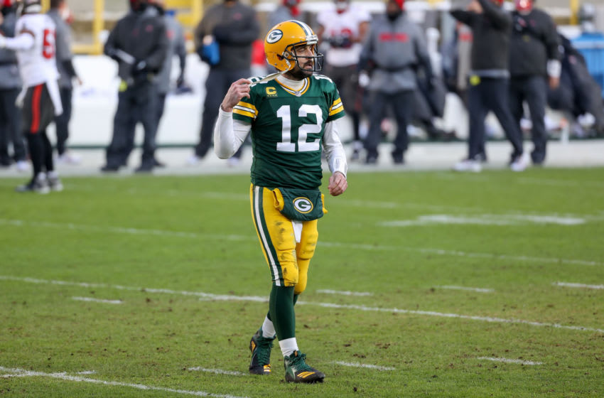 GREEN BAY, WISCONSIN - JANUARY 24: Aaron Rodgers #12 of the Green Bay Packers walks across the field in the second quarter against the Tampa Bay Buccaneers during the NFC Championship game at Lambeau Field on January 24, 2021 in Green Bay, Wisconsin. (Photo by Dylan Buell/Getty Images)