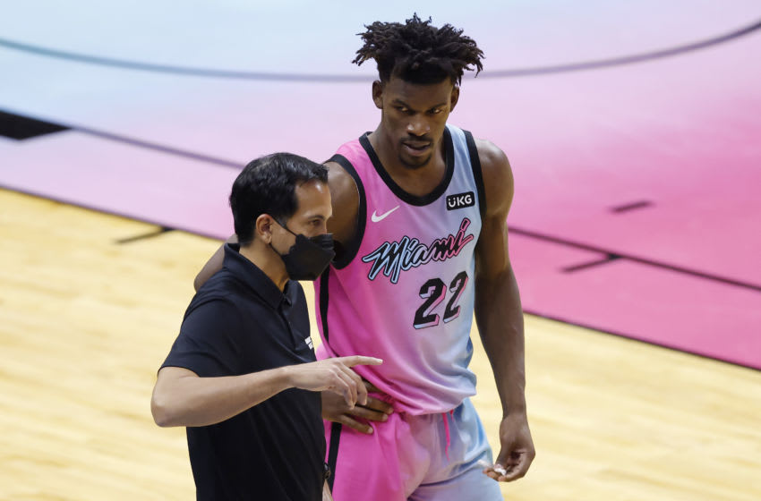 MIAMI, FLORIDA - FEBRUARY 09: Head coach Erik Spoelstra of the Miami Heat talks with Jimmy Butler #22 against the New York Knicks during the fourth quarter at American Airlines Arena on February 09, 2021 in Miami, Florida. NOTE TO USER: User expressly acknowledges and agrees that, by downloading and or using this photograph, User is consenting to the terms and conditions of the Getty Images License Agreement. (Photo by Michael Reaves/Getty Images)