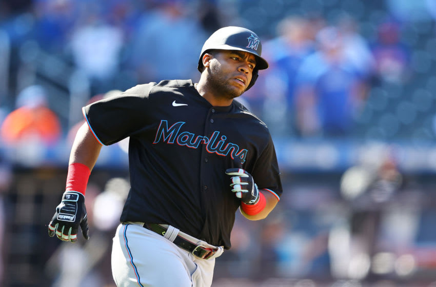 NEW YORK, NEW YORK - APRIL 08: Jesus Aguilar #24 of the Miami Marlins runs to first after hitting a RBI single in the sixth inning against the New York Mets at Citi Field on April 08, 2021 in New York City. (Photo by Mike Stobe/Getty Images)