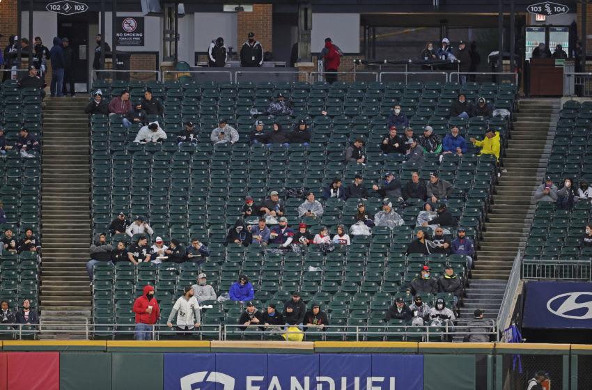 CHICAGO, ILLINOIS - APRIL 08: Fans sit in