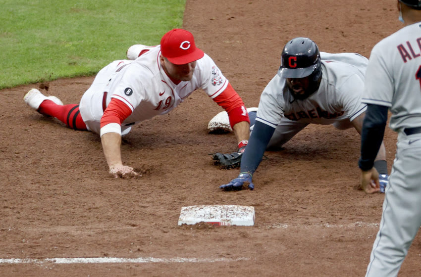 CINCINNATI, OHIO - APRIL 17: Joey Votto #19 of the Cincinnati Reds tags out Franmil Reyes #32 of the Cleveland Indians at first base as part of a triple play in the eighth inning at Great American Ball Park on April 17, 2021 in Cincinnati, Ohio. (Photo by Dylan Buell/Getty Images)