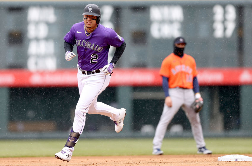 DENVER, COLORADO - APRIL 21: Yonathan Daza #2 of the Colorado Rockies circles the bases after hitting a solo home run against the Houston Astros in the second inning at Coors Field on April 21, 2021 in Denver, Colorado. (Photo by Matthew Stockman/Getty Images)