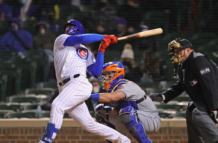 CHICAGO, ILLINOIS - APRIL 21: Javier Baez #9 of the Chicago Cubs hits a grand slam home run in the 6th inning against the New York Mets at Wrigley Field on April 21, 2021 in Chicago, Illinois. (Photo by Jonathan Daniel/Getty Images)