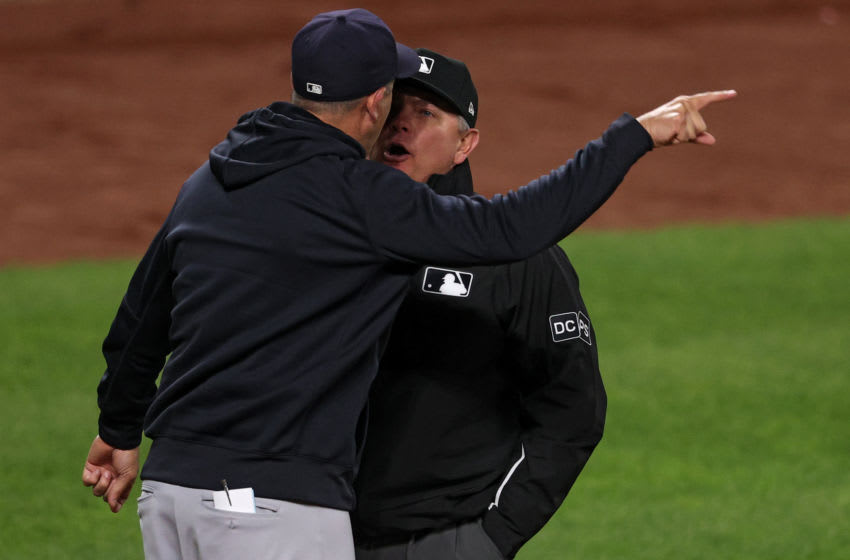 New York Yankees manager Aaron Boone yells at umpire (Photo by Patrick Smith/Getty Images)