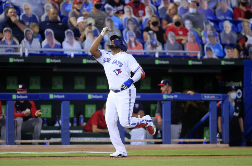 DUNEDIN, FLORIDA - APRIL 27: Vladimir Guerrero Jr. #27 of the Toronto Blue Jays reacts to his a grand-slam home run in the third inning against the Washington Nationals at TD Ballpark on April 27, 2021 in Dunedin, Florida. (Photo by Sam Greenwood/Getty Images)