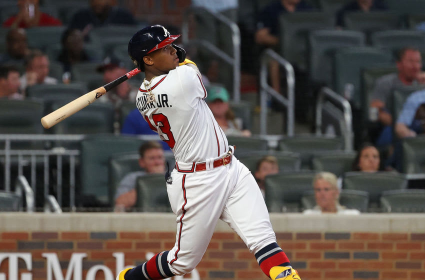 ATLANTA, GEORGIA - APRIL 27: Ronald Acuna Jr. #13 of the Atlanta Braves hits a solo homer in the fifth inning against the Chicago Cubs at Truist Park on April 27, 2021 in Atlanta, Georgia. (Photo by Kevin C. Cox/Getty Images)