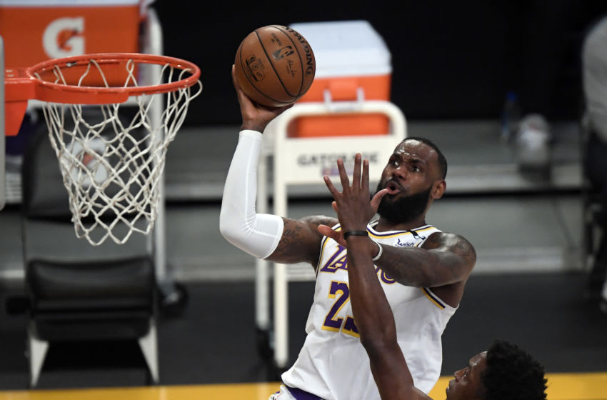 LOS ANGELES, CA - MAY 02: LeBron James #23 of the Los Angeles Lakers scores a basket against Stanley Johnson #5 of the Toronto Raptors during the first half at Staples Center on May 2, 2021 in Los Angeles, California. NOTE TO USER: User expressly acknowledges and agrees that, by downloading and or using this photograph, User is consenting to the terms and conditions of the Getty Images License Agreement. (Photo by Kevork Djansezian/Getty Images)
