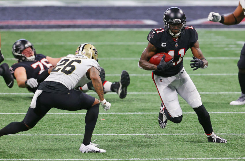 ATLANTA, GEORGIA - DECEMBER 06: Julio Jones #11 of the Atlanta Falcons makes the reception and goes up against Isaiah Oliver #26 of the Atlanta Falcons at Mercedes-Benz Stadium on December 06, 2020 in Atlanta, Georgia. (Photo by Kevin C. Cox/Getty Images)