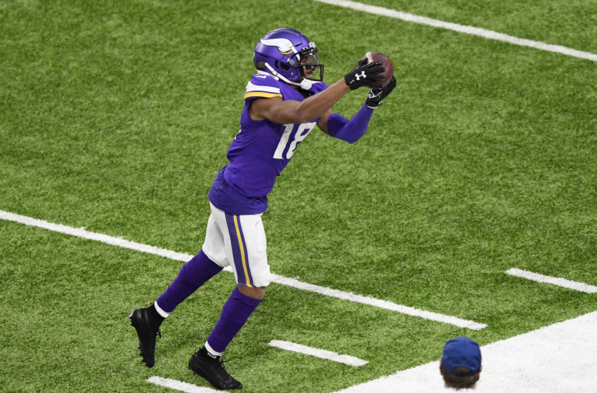 MINNEAPOLIS, MINNESOTA - DECEMBER 20: Justin Jefferson #18 of the Minnesota Vikings makes a reception along the sideline during the fourth quarter against the Chicago Bears at U.S. Bank Stadium on December 20, 2020 in Minneapolis, Minnesota. (Photo by Hannah Foslien/Getty Images)