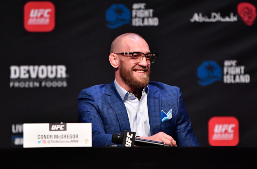 ABU DHABI, UNITED ARAB EMIRATES - JANUARY 21: In this handout image provided by the UFC, Conor McGregor of Ireland interacts with media during the UFC 257 press conference event inside Etihad Arena on UFC Fight Island on January 21, 2021 in Yas Island, Abu Dhabi, United Arab Emirates. (Photo by Jeff Bottari/Zuffa LLC via Getty Images)