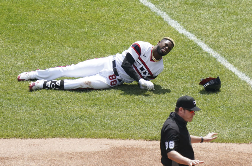 CHICAGO, ILLINOIS - MAY 02: Luis Robert #88 of the Chicago White Sox gets injured after reaching first base on a single during the first inning of a game against the Cleveland Indians at Guaranteed Rate Field on May 02, 2021 in Chicago, Illinois. (Photo by Nuccio DiNuzzo/Getty Images)